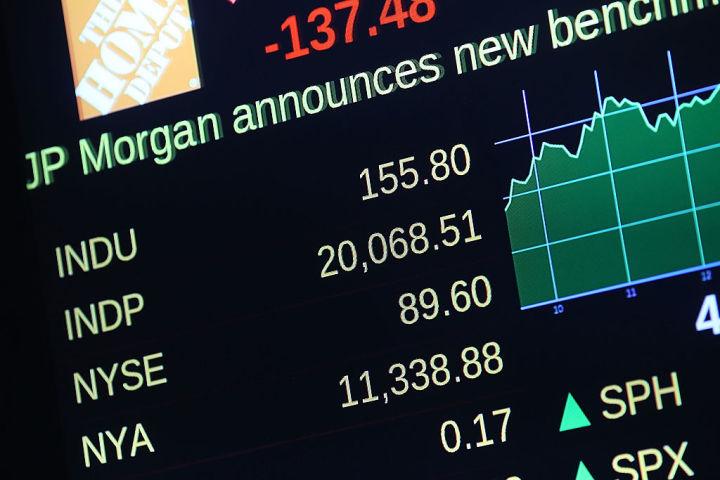 米株ダウ平均2万ドル台突破、120年の歴史で史上初